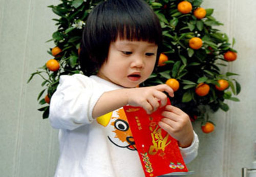 A child receives lucky money in a red envelope for chinese new year
