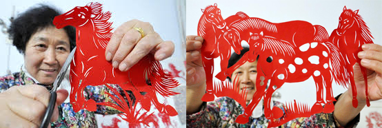 Chinese woman cutting paper to make horse art for Chinese New Year 2014