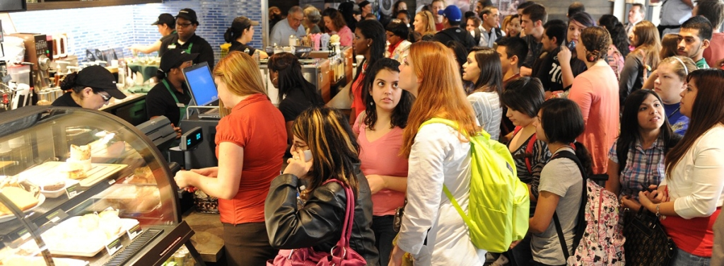 People congregate and meet inside a Starbucks cafe for coffee and food