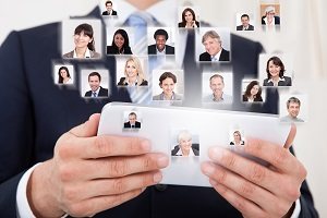 Collage of business people with businessman using digital tablet